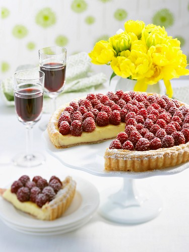 White chocolate tart with raspberries, sliced