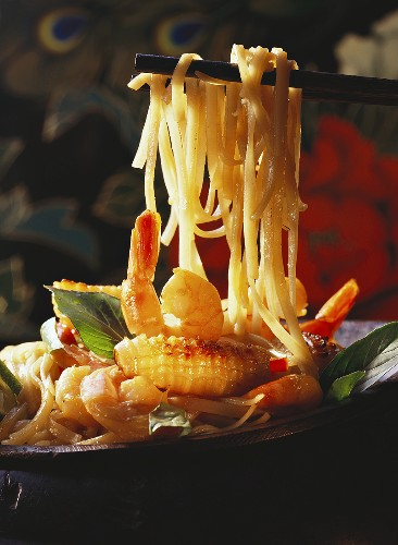 Chop Sticks Picking Up Pasta From a Noodle and Seafood Dish
