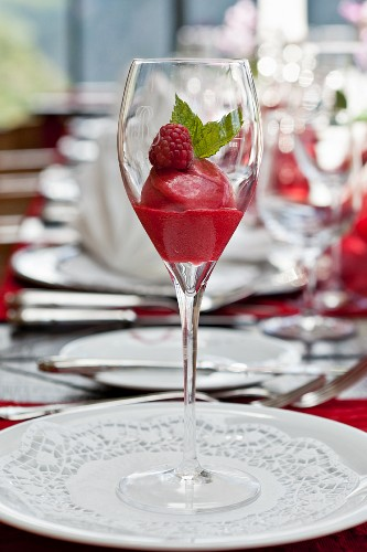 Raspberry sorbet and fresh mint in a champagne glass