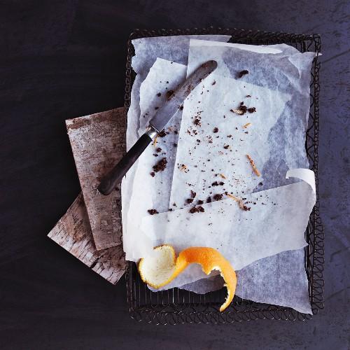 Cake crumbs and orange peel on baking paper