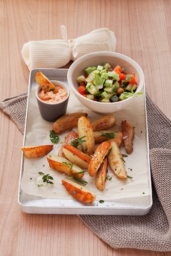 Vegetable salad, roasted potato wedges and cocktail dip