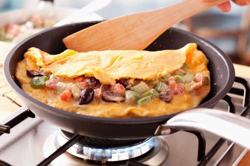 Vegetable omelette in frying pan