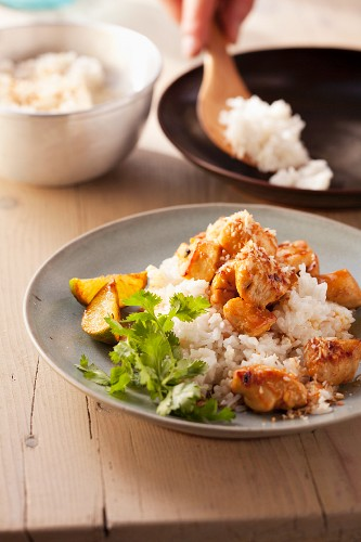Fried chicken with dessicated coconut on coconut rice