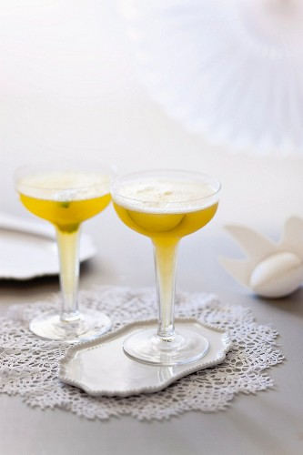 Champagne cocktail with passion fruit and limes