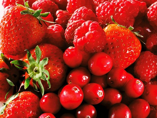 Strawberries, raspberries and cranberries (fills the screen)