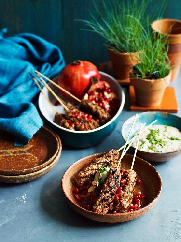 Minced lamb kebabs with pomegranate seeds and a yogurt dip