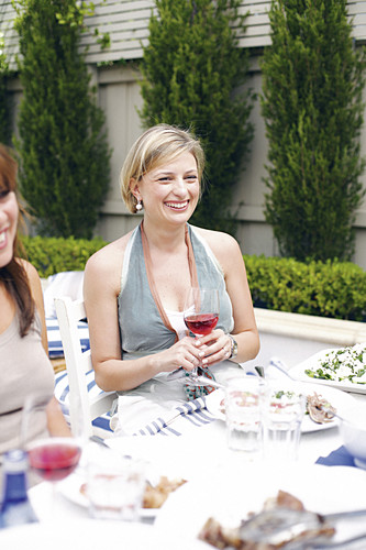 A smiling woman at a dinner party