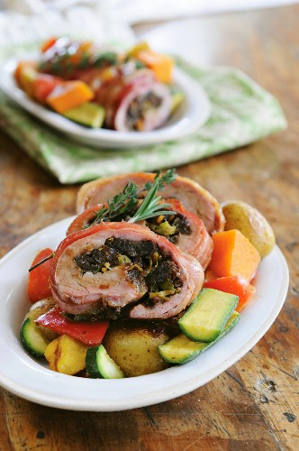 Rolled pork with date and citrus stuffing on roast vegetables