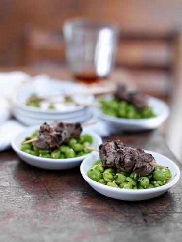 Lamb skewers on bean salad