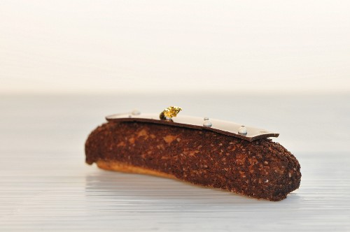 A chocolate cake decorated with gold leaf