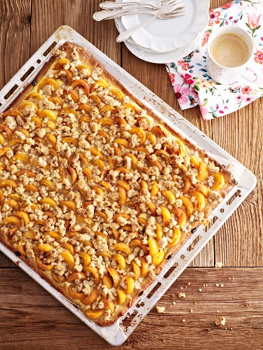Apricot crumble cake in a baking tray