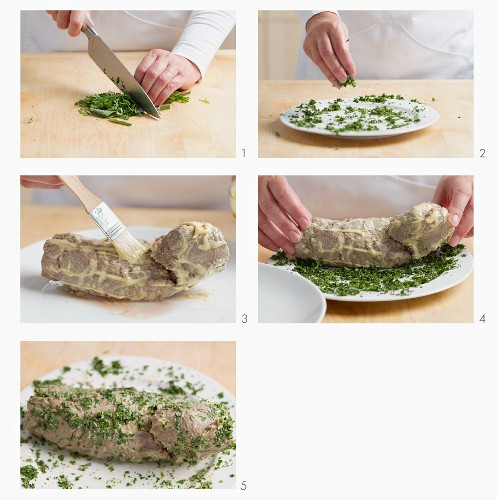 Steamed veal fillet being rolled in herbs