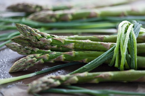 Fresh green asparagus tied with chives