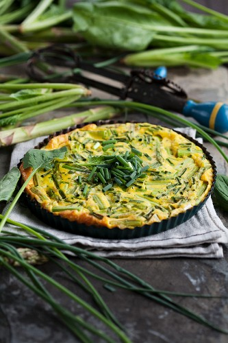Egg cake with green asparagus and chives