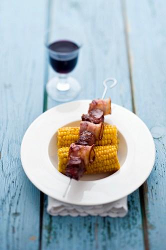 Beef cheek kebab on corn cobs