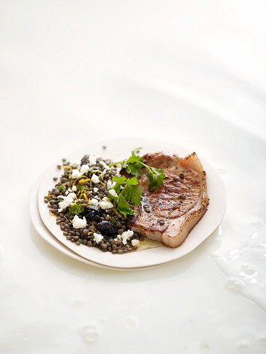 Pork cutlet with lentil and sheep's cheese salad