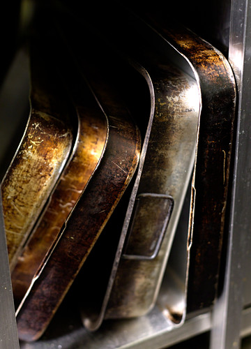 Roasting tins of various sizes in a restaurant kitchen