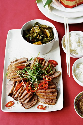 Duck breast with chilli salt, a chilli medley and rice