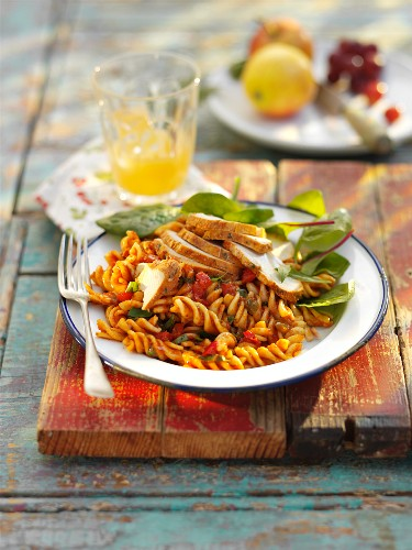 Pasta salad with chicken, tomatoes and basil