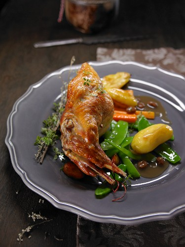 Rabbit with potatoes, sugar snap peas and carrots