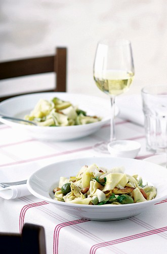Herb papardelle with artichokes, olives and almonds