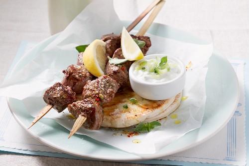 Souvlaki (Greek meat kebabs) with tzaziki and pita bread
