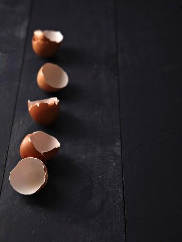 Egg shells on a black surface