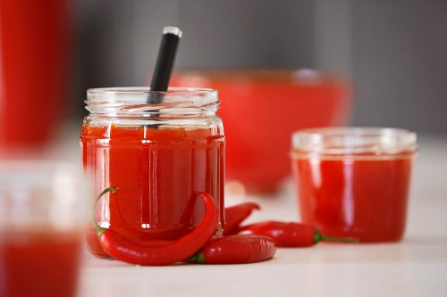Pepper and chilli chutney in jars