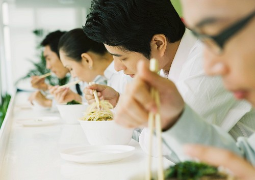 Business executives eating in cafeteria