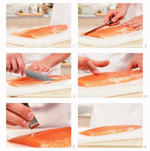 A salmon fillet being deboned