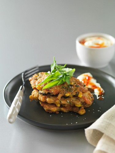 Mussel and corn cakes with sour cream and chilli sauce
