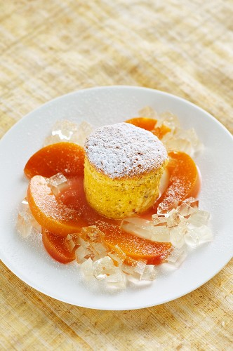 White chocolate souffle with vineyard peaches and champagne jelly