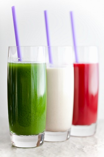 Three Assorted Smoothies in Glasses with Straws