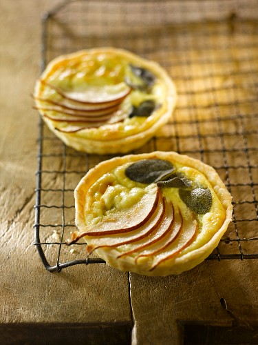 Two Mini Stilton Cheese and Pear Tarts; On a Cooling Rack