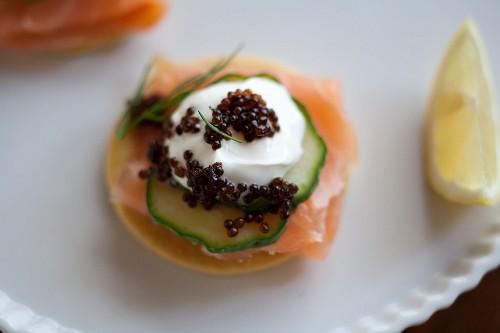 Lox, Caviar, Creme Fraiche and Cucumber atop a Cracker