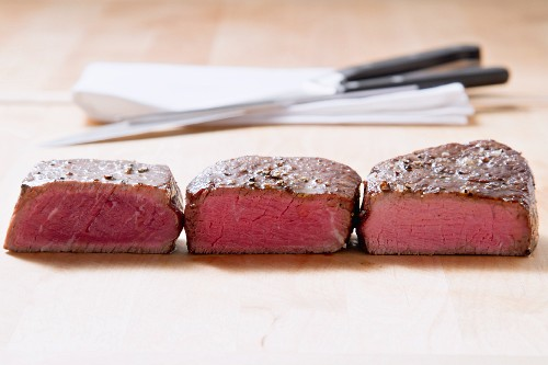 Fried fillet steaks with different levels of doneness