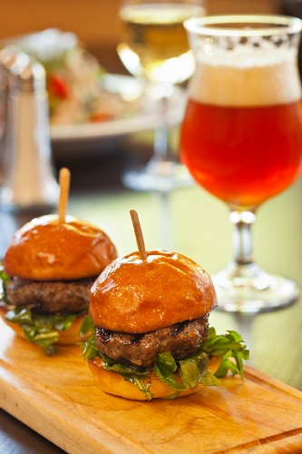 Two Slider Burgers with a Glass of Beer