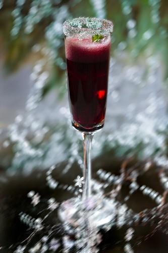 A raspberry aperitif with a sugared edge