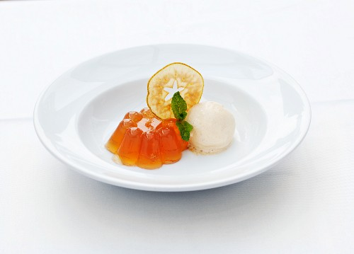 Jelly with ice cream, sliced apple and mint