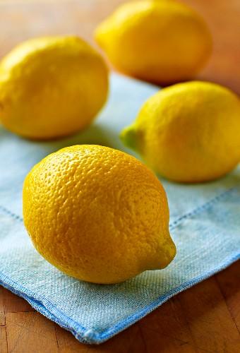Four Whole Lemons on Blue Linen Napkin