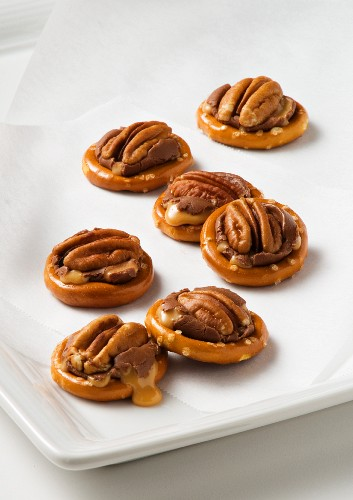 Pretzels with pecan nuts, chocolate and caramel