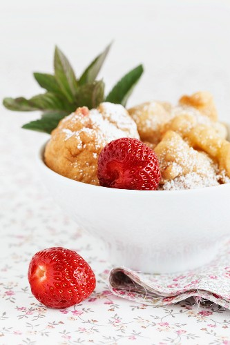 Strawberry doughnuts in a bowl