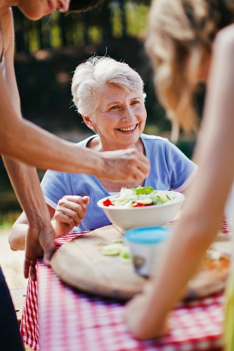 Older woman sitting at picnic table