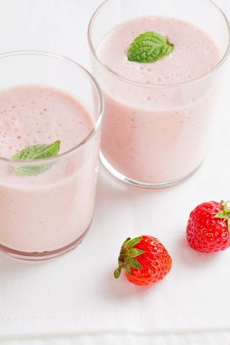 Two strawberry milkshakes