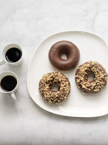 Dark Chocolate Covered Donuts; Two with Chopped Hazelnuts