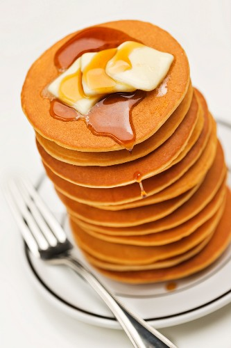 Tall Stack of Pancakes with Butter and Maple Syrup