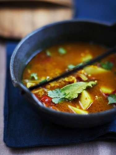 Curry soup with potatoes and chilli peppers