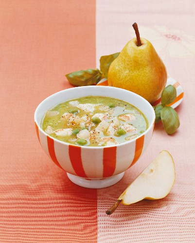 Cream of pea soup with pear and lobster