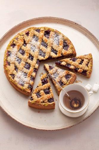 Linzer torte (nut and jam layer cake) on a white plate