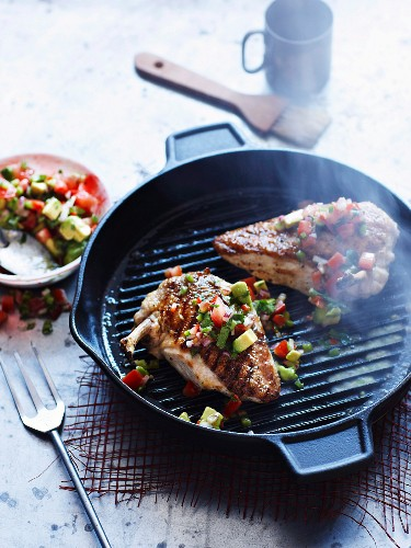 Grilled chicken with tomato and avocado salsa
